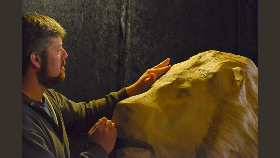 Aaron Yount sculpting monumental lion